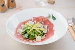 Beef carpaccio, blacktruffle dressing, mache salad