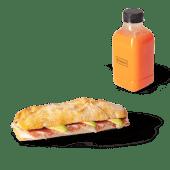 Menú panino de pollo, aguacate y brie (caliente) + zumo (500 ml.)