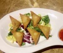 Empanada triangular rellena