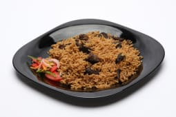 Pilau served with beef fry