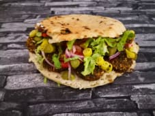 Lebanese Falafel in Taameya Bread with Fresh Vegetables, Pickles
