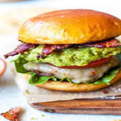 Guacamole Bacon Cheese Burger served with chips or salad