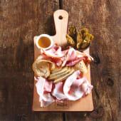 Porchetta Tiepida con carciofi Rustici & Misticanza