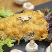 Свинина по-київськи запечена з грибами (120г)