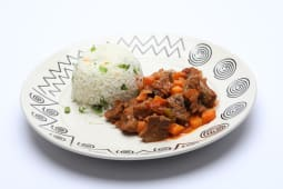 Rice served with beef stew