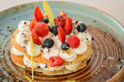 Pancake with mascarpone cream and forest fruit