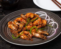 Dry prawns in chili garlic(in the shell).
