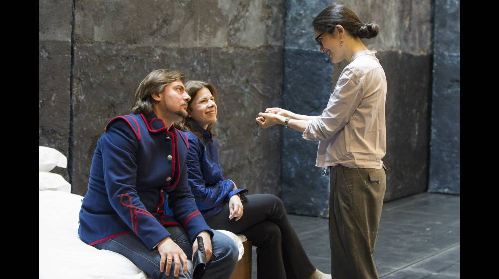 Director Mariame Clément (standing), talking with Igor Golovatenko (Severo) and Ana María Martínez (Paolina) during rehearsals for the 2015 Glyndebourne Festival production of Poliuto.