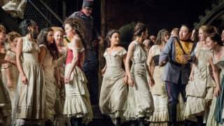 Carmen, Glyndebourne Festival 2015. Carmen (Stéphanie d'Oustrac), Mercédès (Rihab Chaieb), Frasquita (Eliana Pretorian) and Zungia (Simon Lim) with members of the Glyndebourne Chorus.