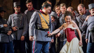 Carmen, Glyndebourne Festival 2015. Zuniga (Simon Lim) and Carmen (Stéphanie d'Oustrac).