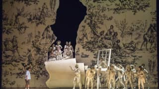 Glyndebourne Festival 2015, L'enfant et les sortilèges.  Child (Danielle de Niese) with Glyndebourne Chorus as wallpaper figures. Photographer: Richard Hubert Smith