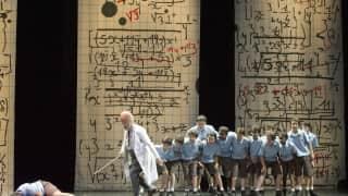 Glyndebourne Festival 2015, L'enfant et les sortilèges.  Child (Danielle de Niese), Little Old Man Arithmetic (François Piolino). Photographer: Richard Hubert Smith