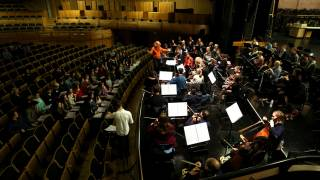 In the afternoon the chorus and the orchestra came together to rehearse in the auditorium.