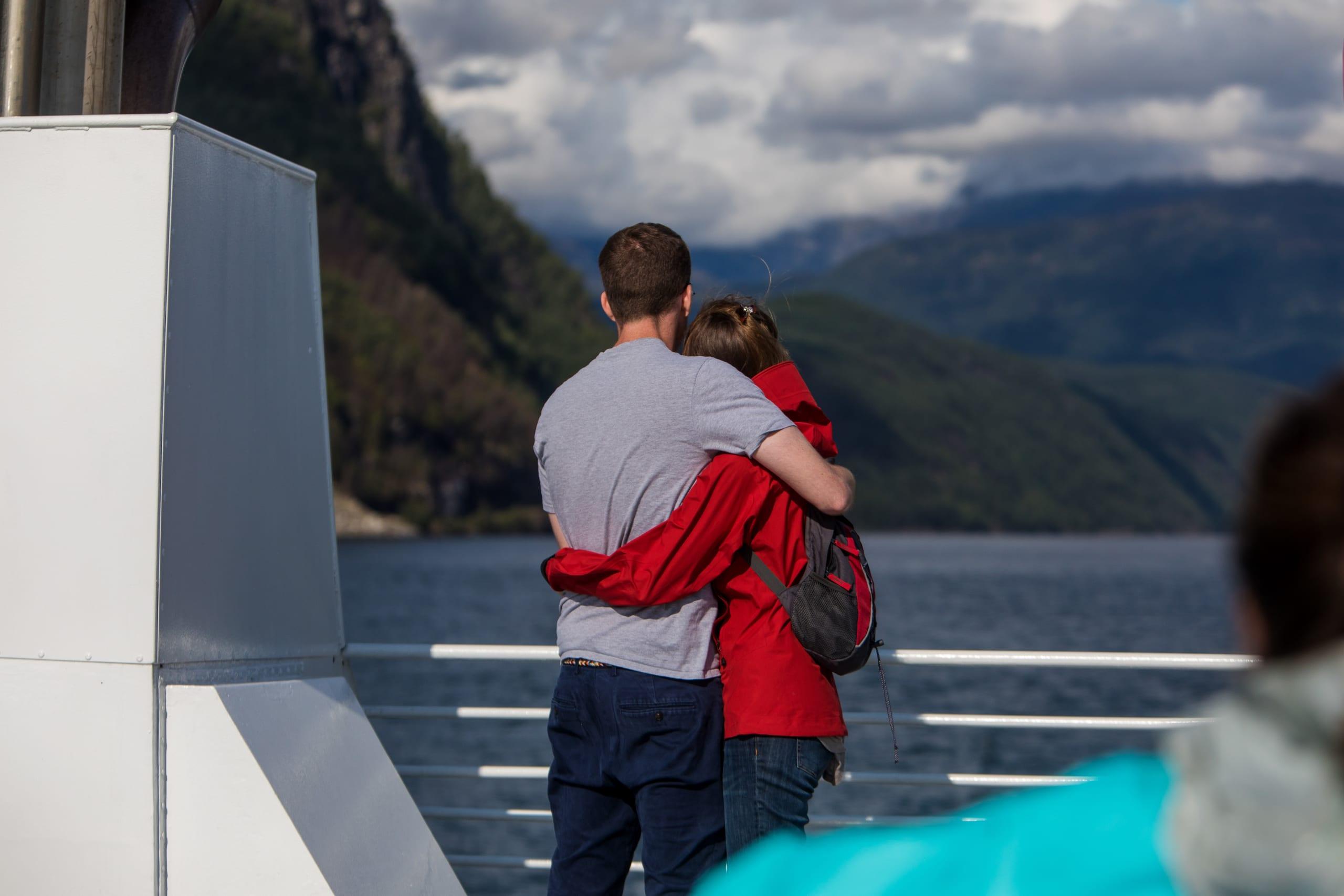 Couple enjoying the fjord cruise on Hardangerfjord