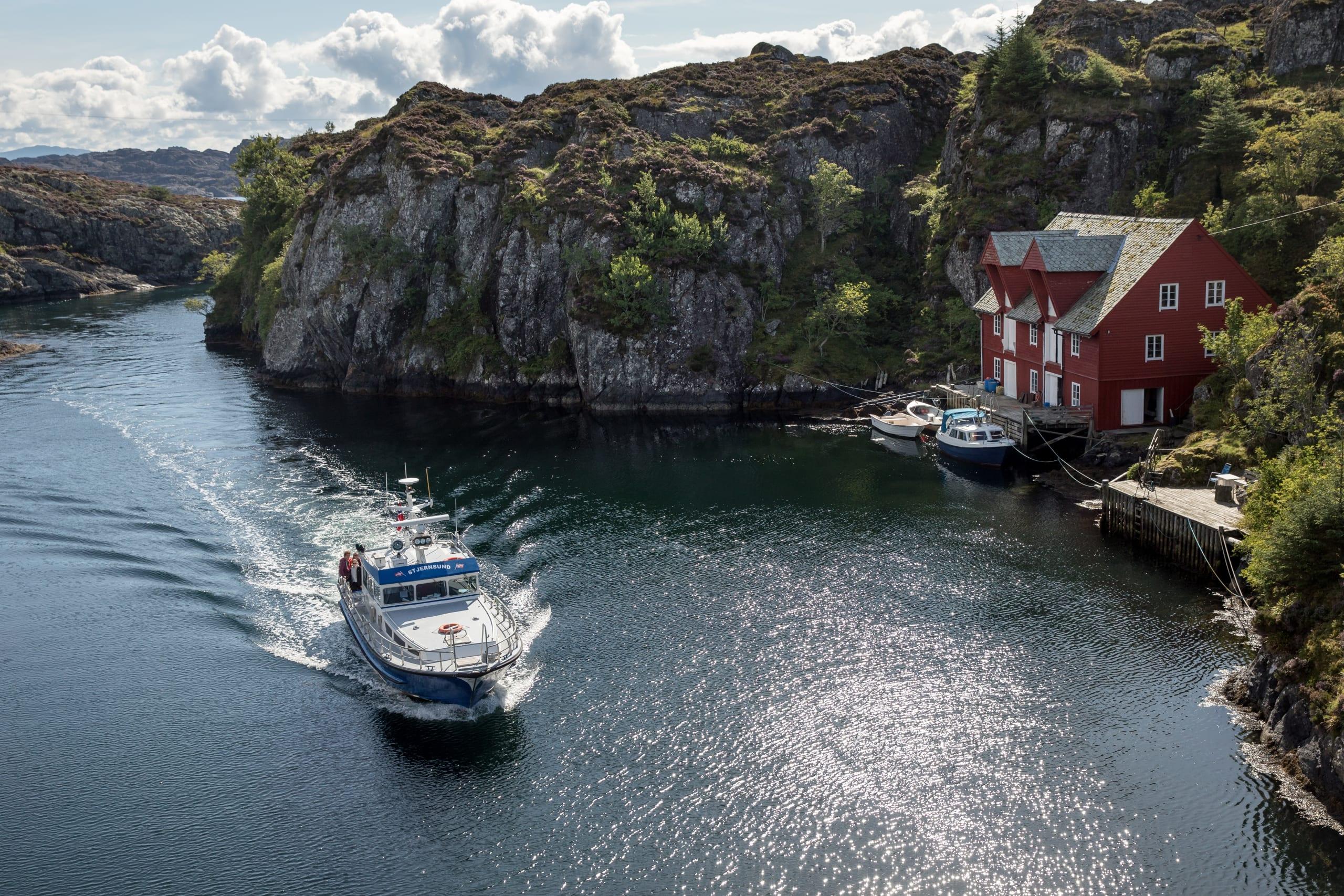 Postal boat sailing in the archipelago of Bulandet