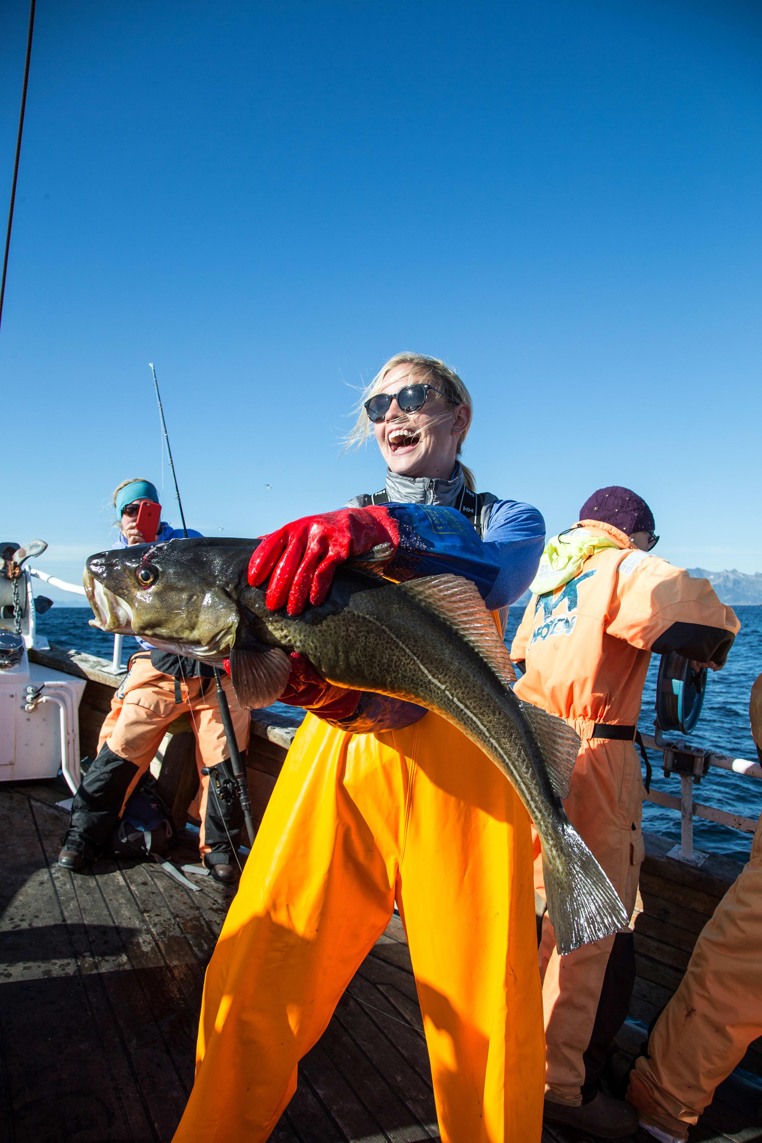Happy woman with a big arctic cod