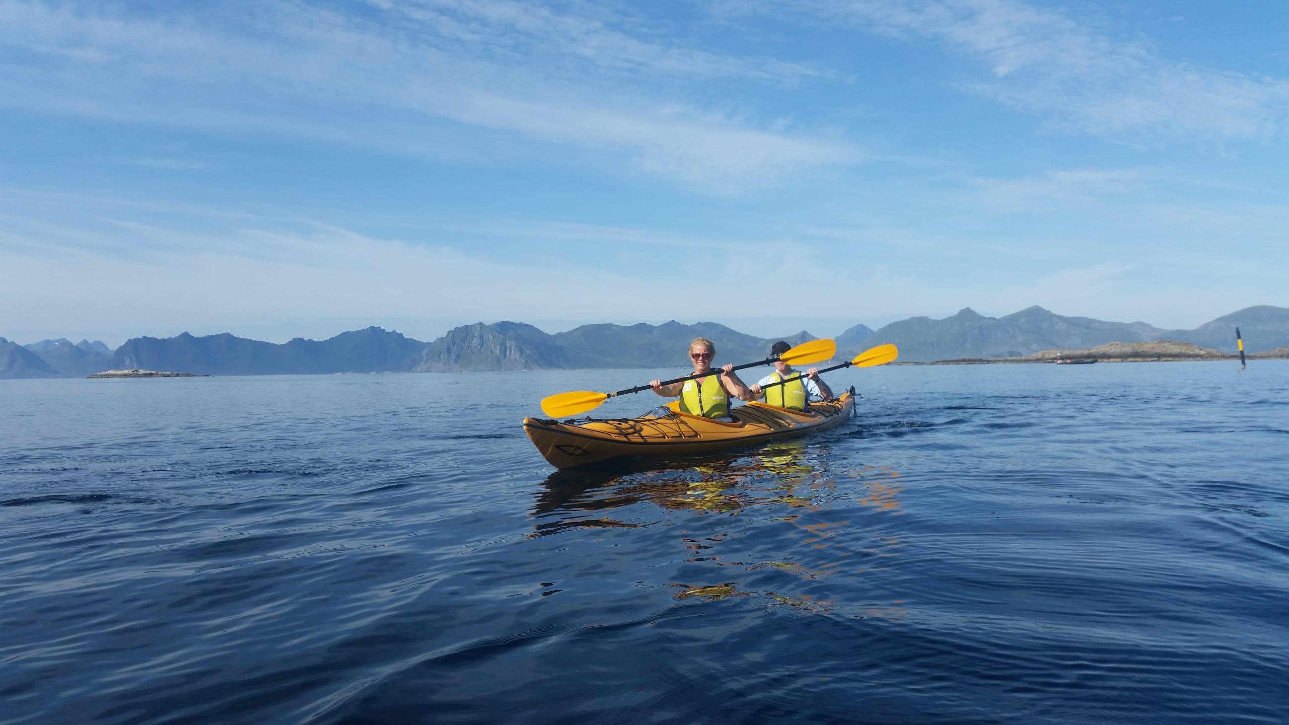 Couple kayaking in Lofoten