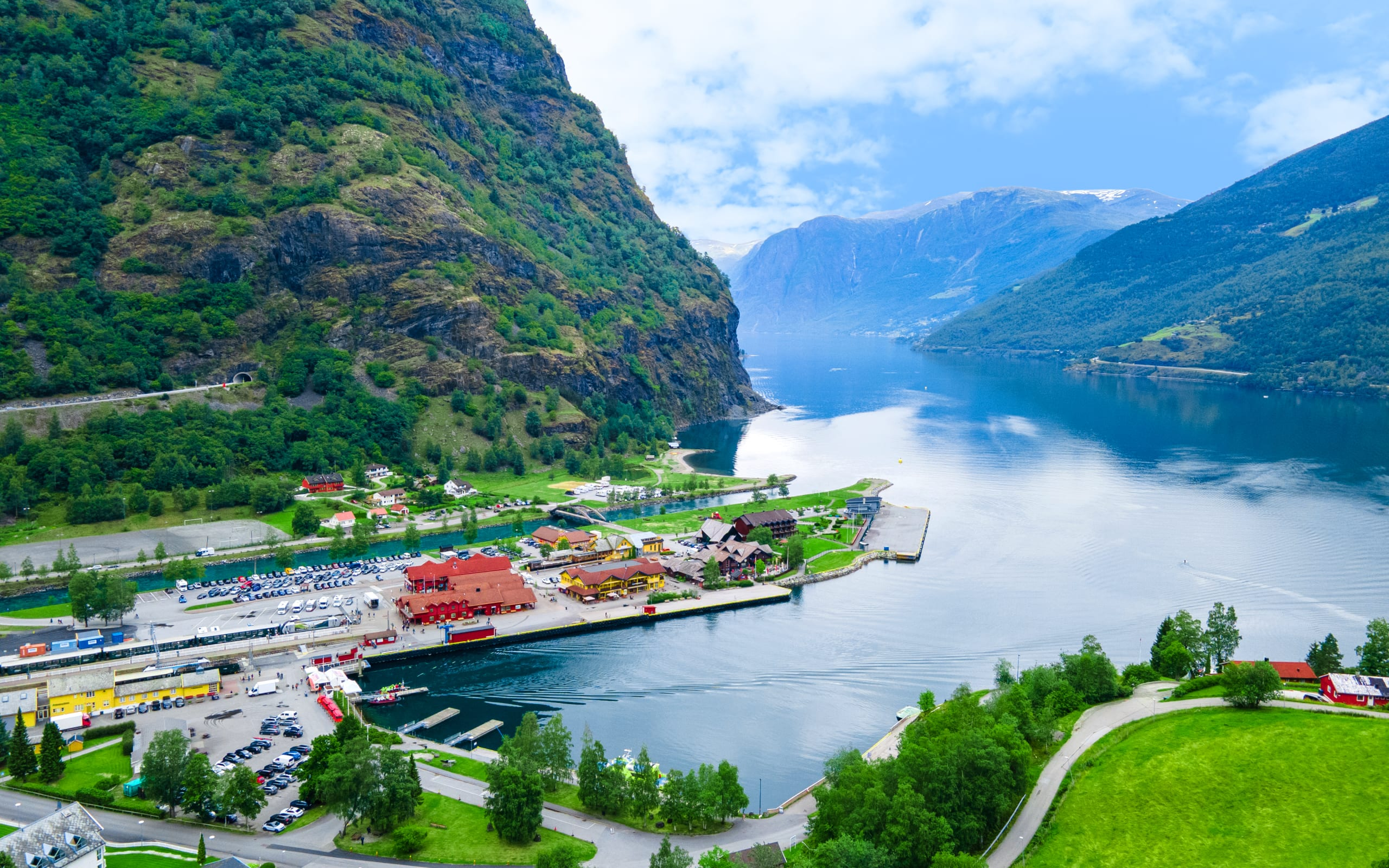 The harbor area of Flåm with lush mountainsides