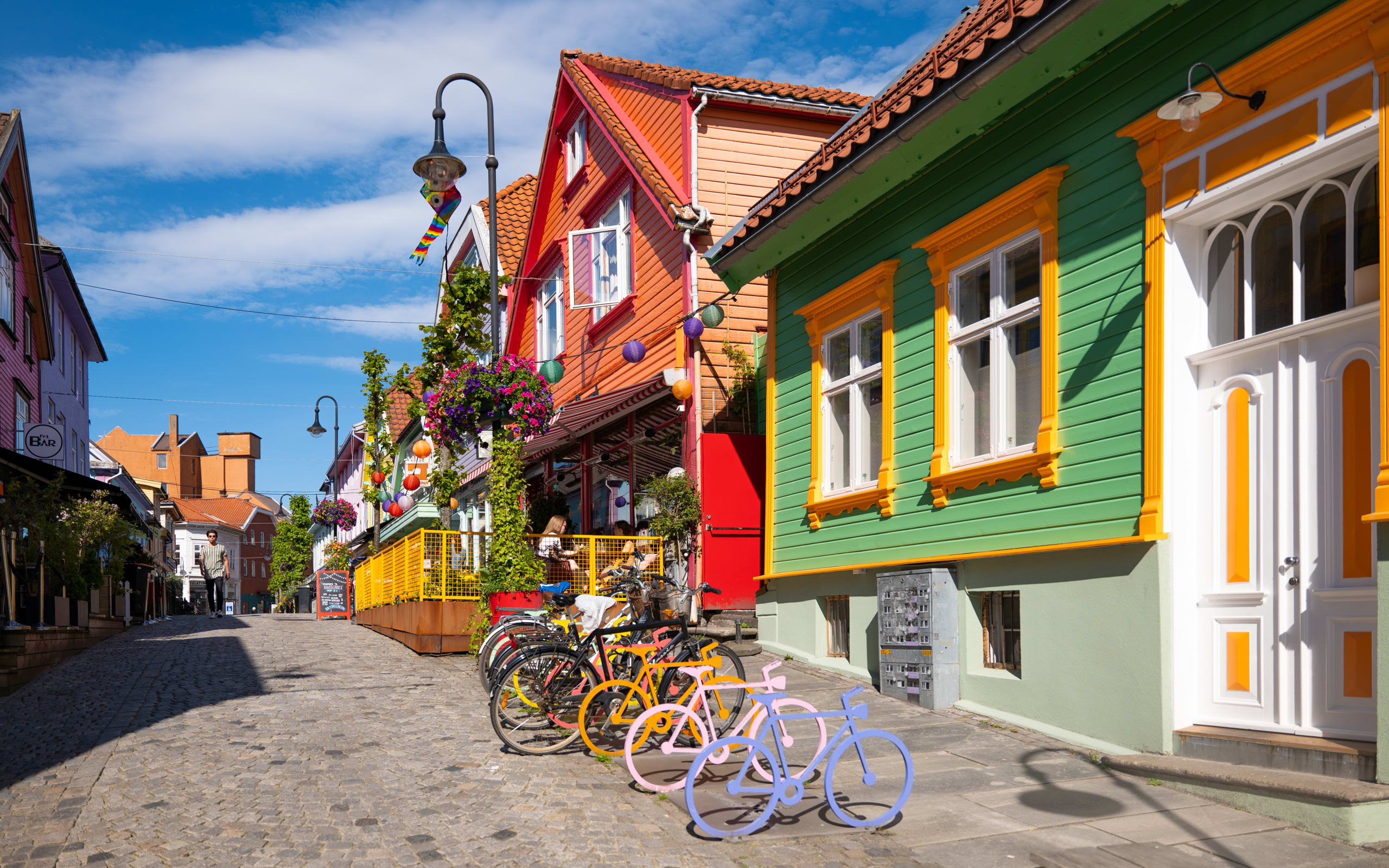 Colorful wooden houses create a warm atmosphere