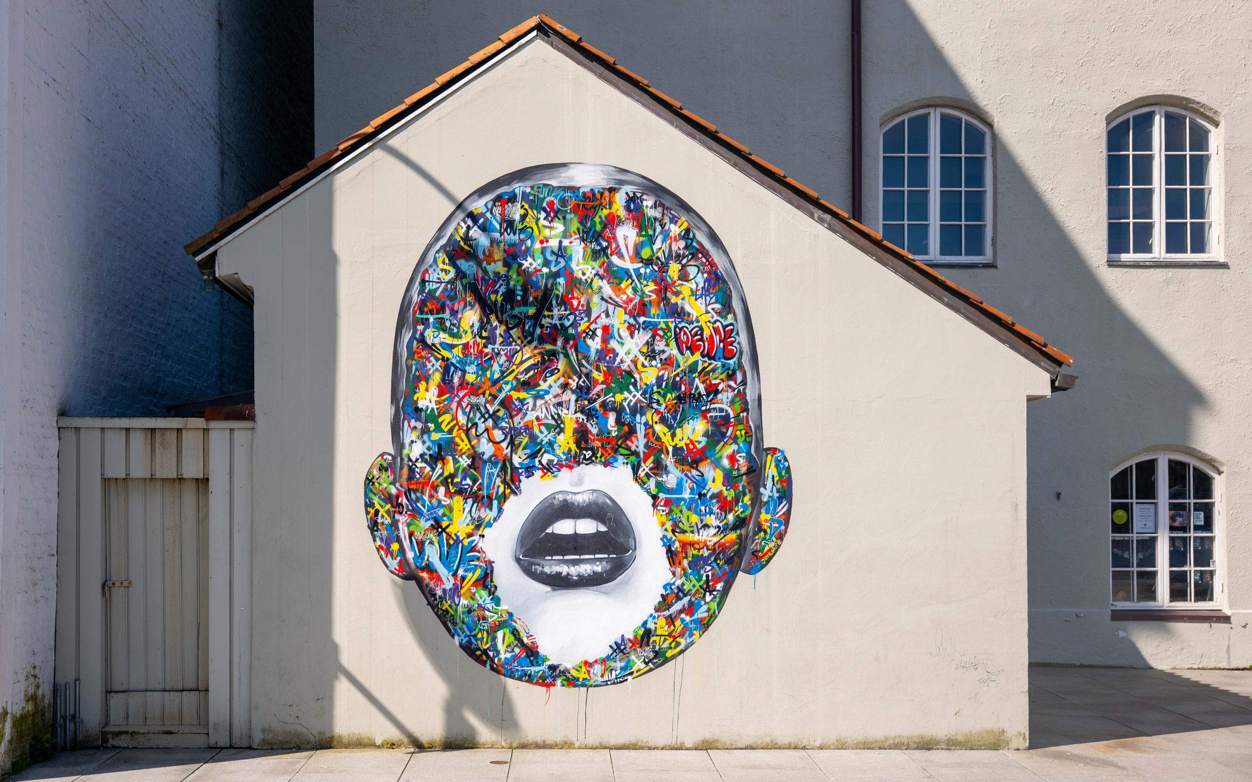 Street art on a factory wall in city of Stavanger