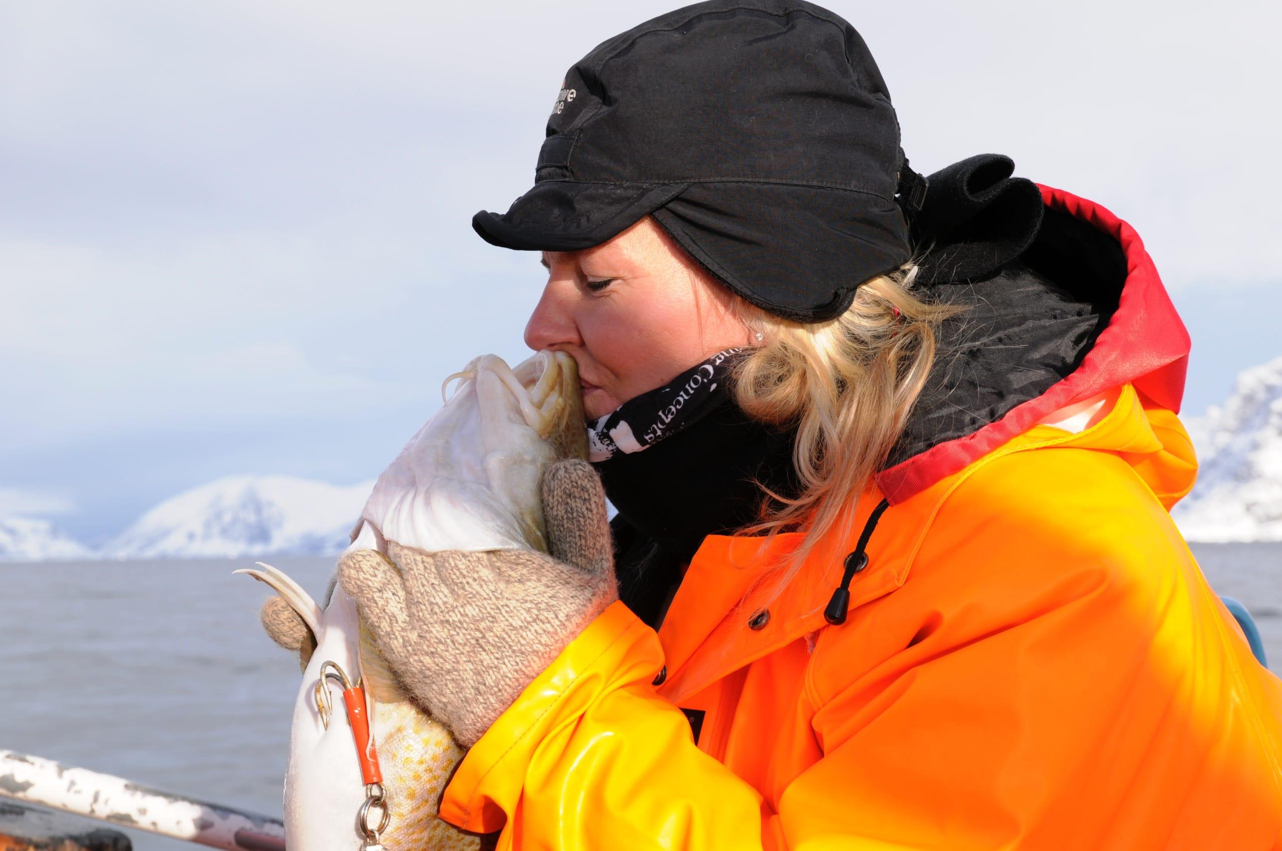 Woman kissing arctic cod