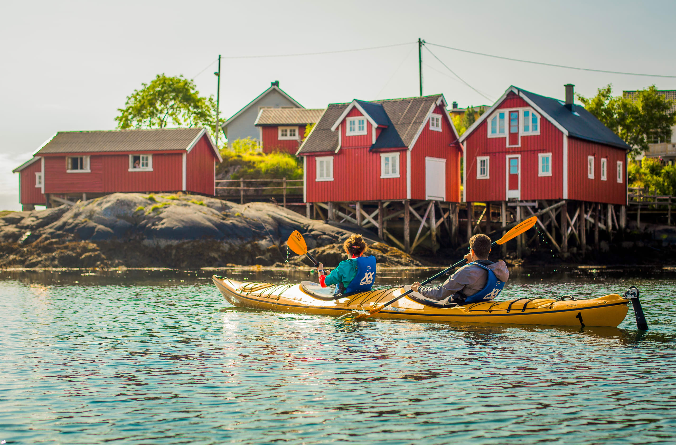 Kayaking past fishing huts in Lofoten