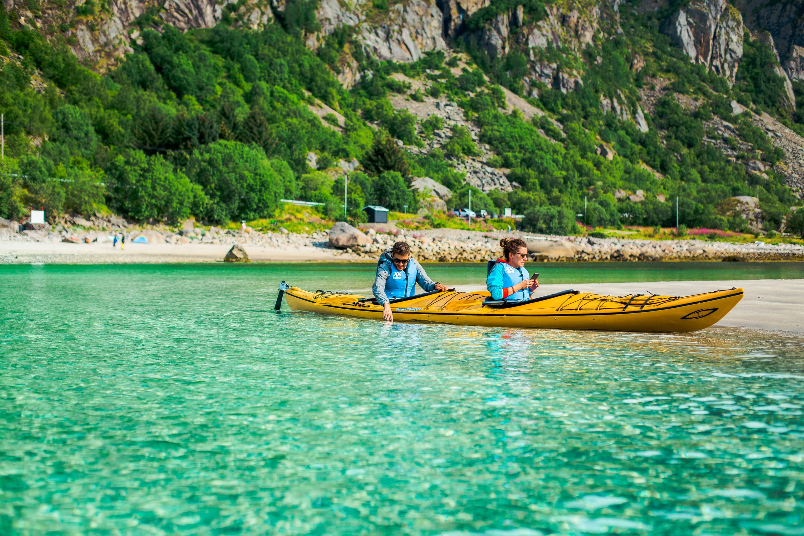 Kayaking in crystal clear water in Lofoten