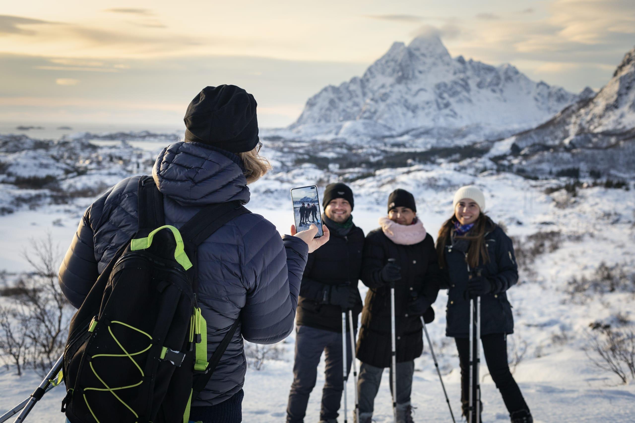 Snowshoeing hikers taking photos