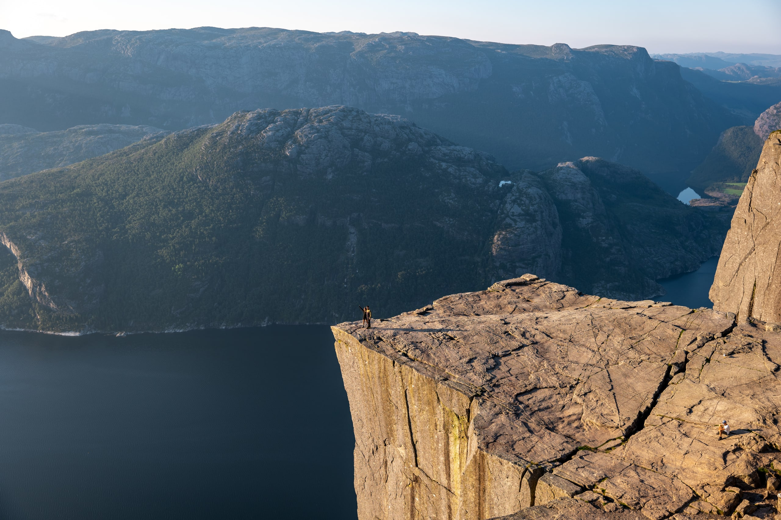 Couple posing on the tip of Preikestolen