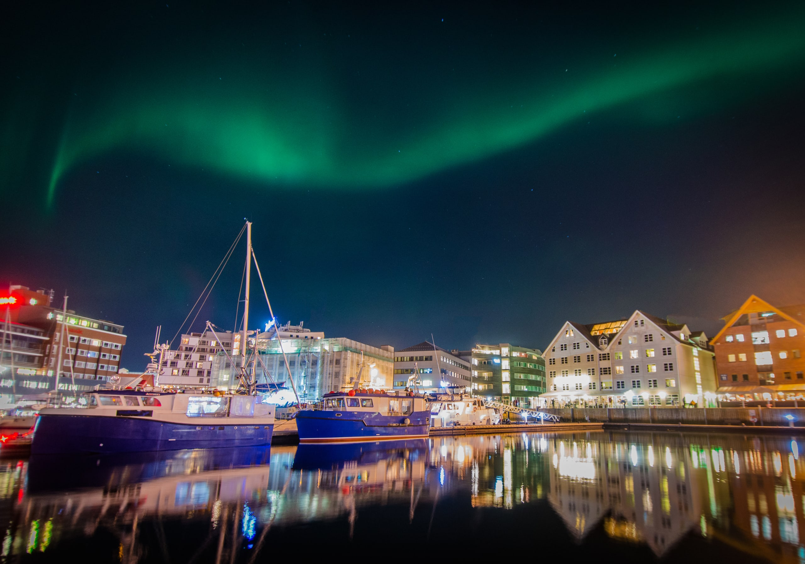 Northern lights over the waterfront of Tromsø