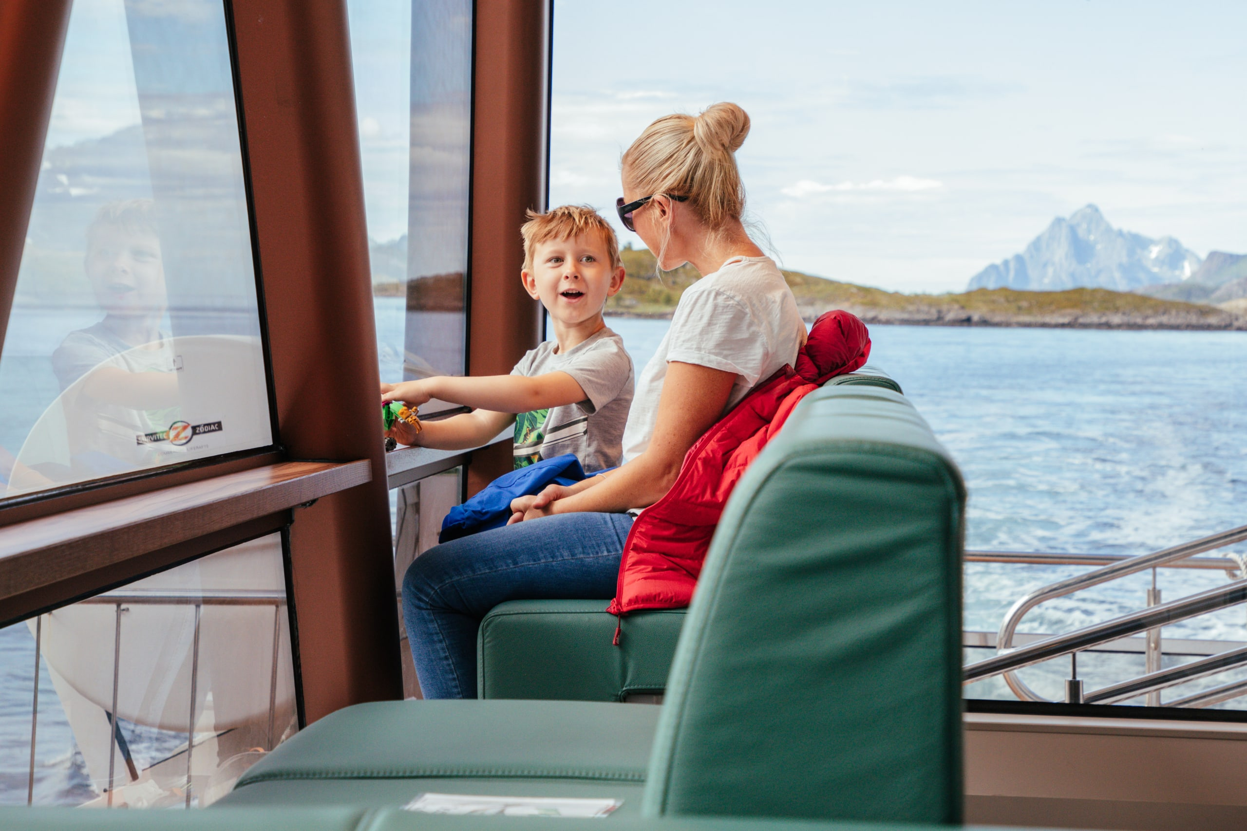 Woman and child on silent Trollfjord cruise with Brim