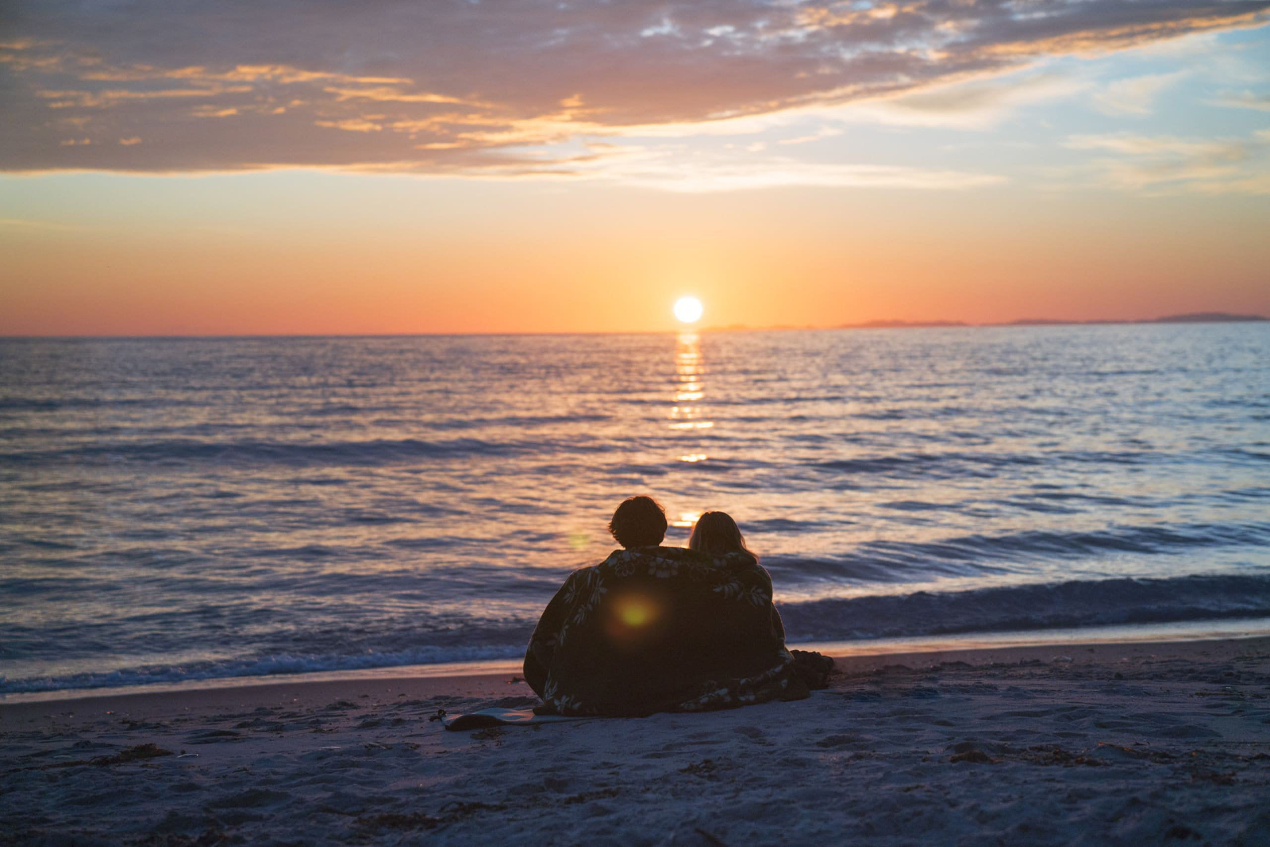 Couple enjoying the midnight sun