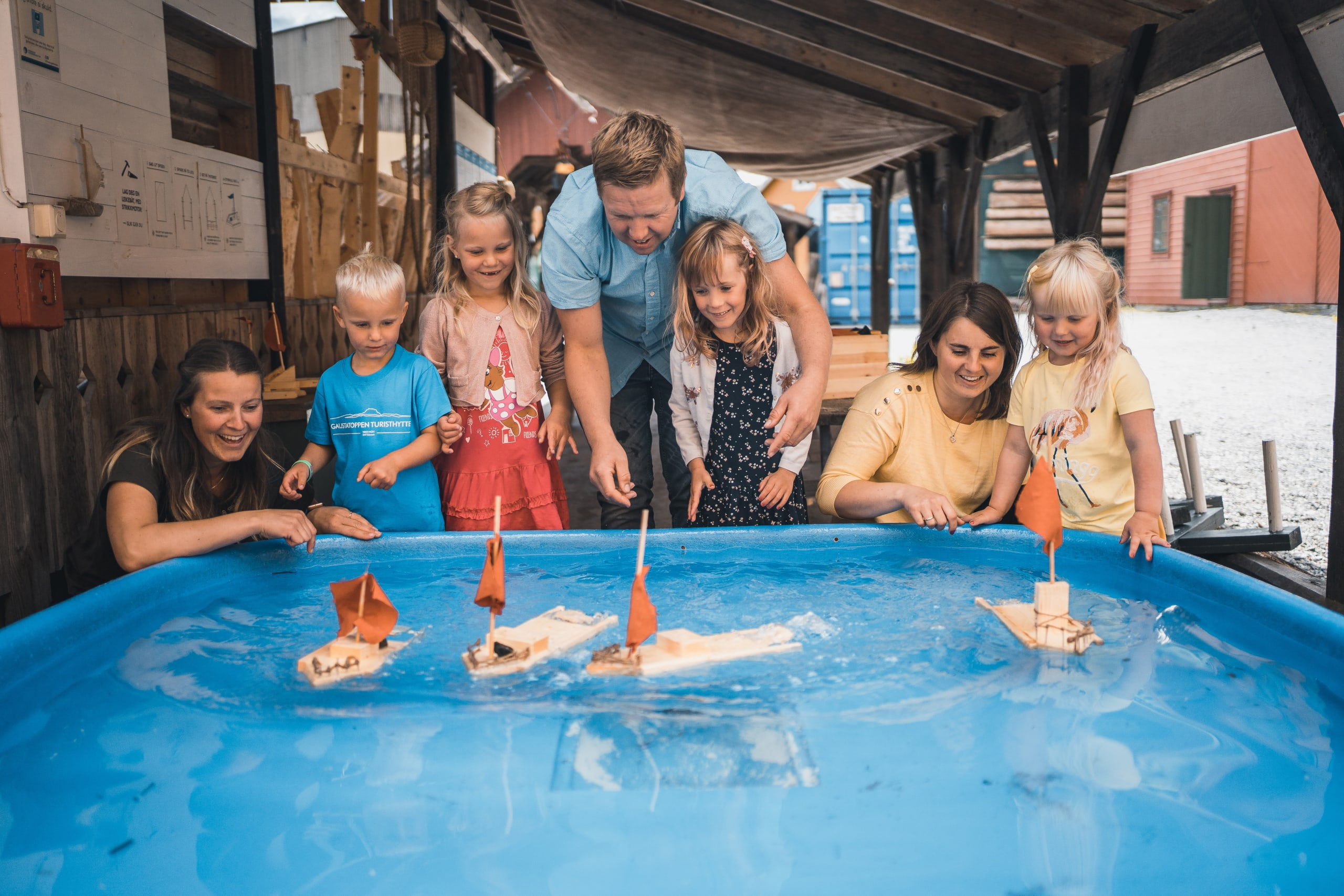 Family doing water activities at Hardanger Maritime Museum