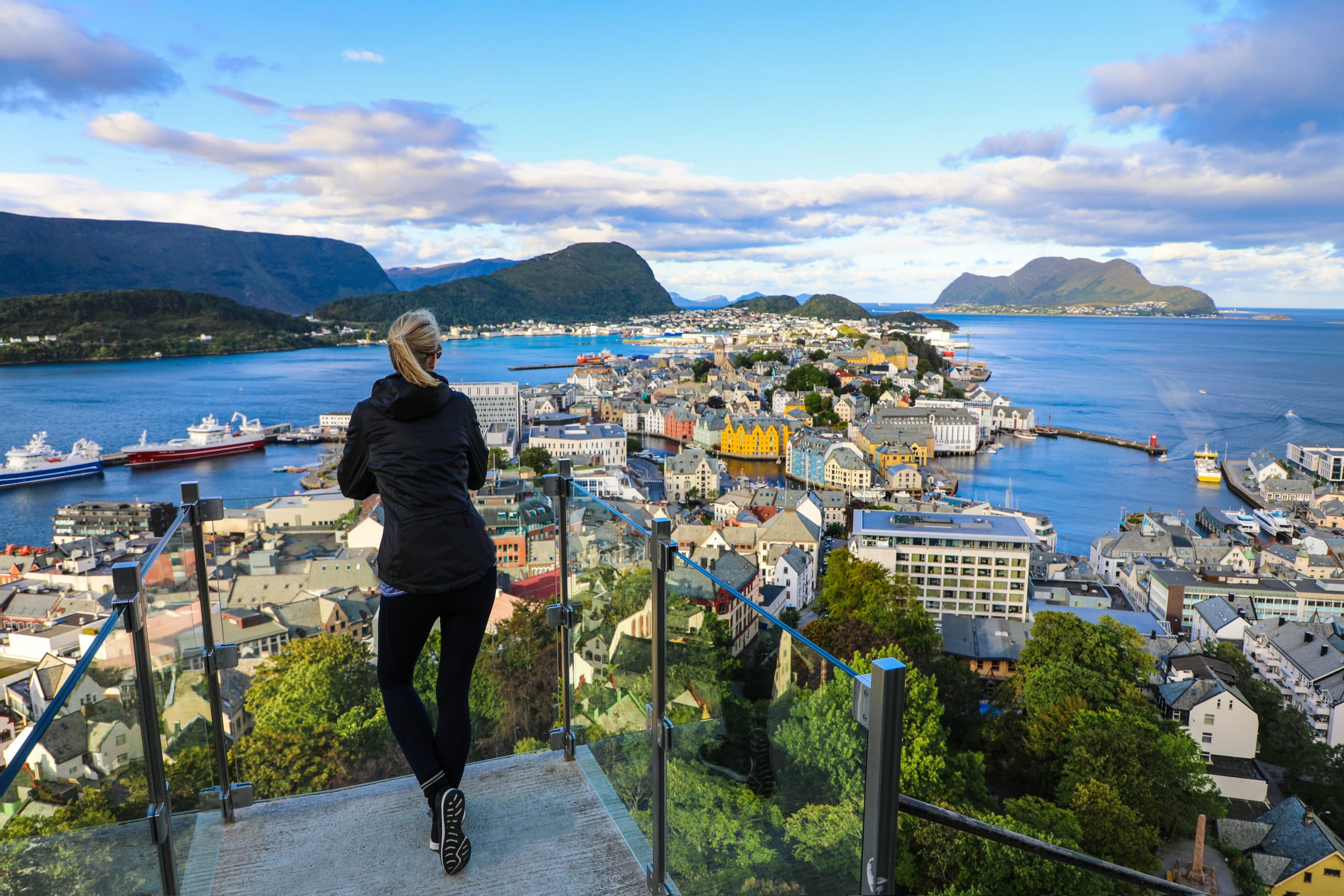 Woman taking in the view of Ålesund from Mt Aksla