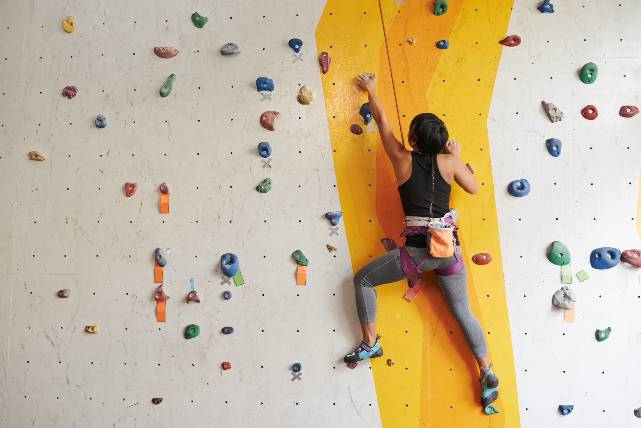 woman on top rope climbing course at Tindesenteret