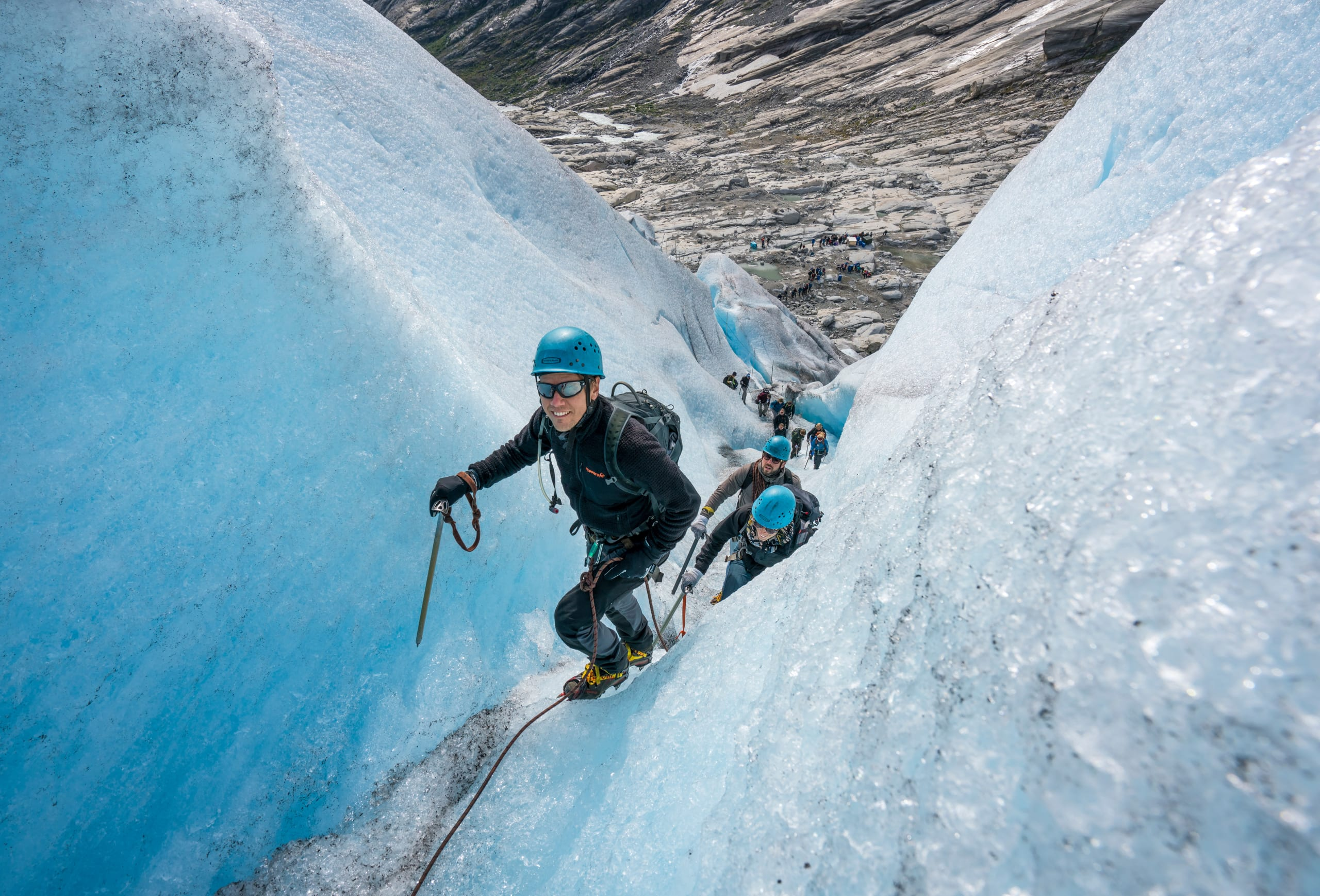 Climbing a deep crevasse at Nigardsbreen