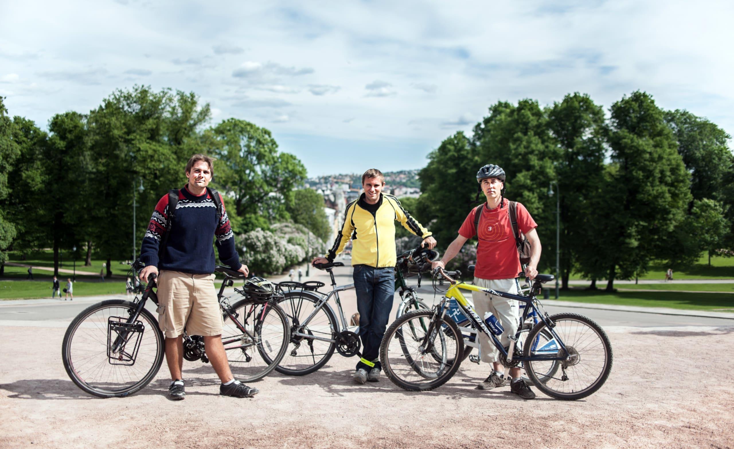 Three tourists exploring Oslo by bike.