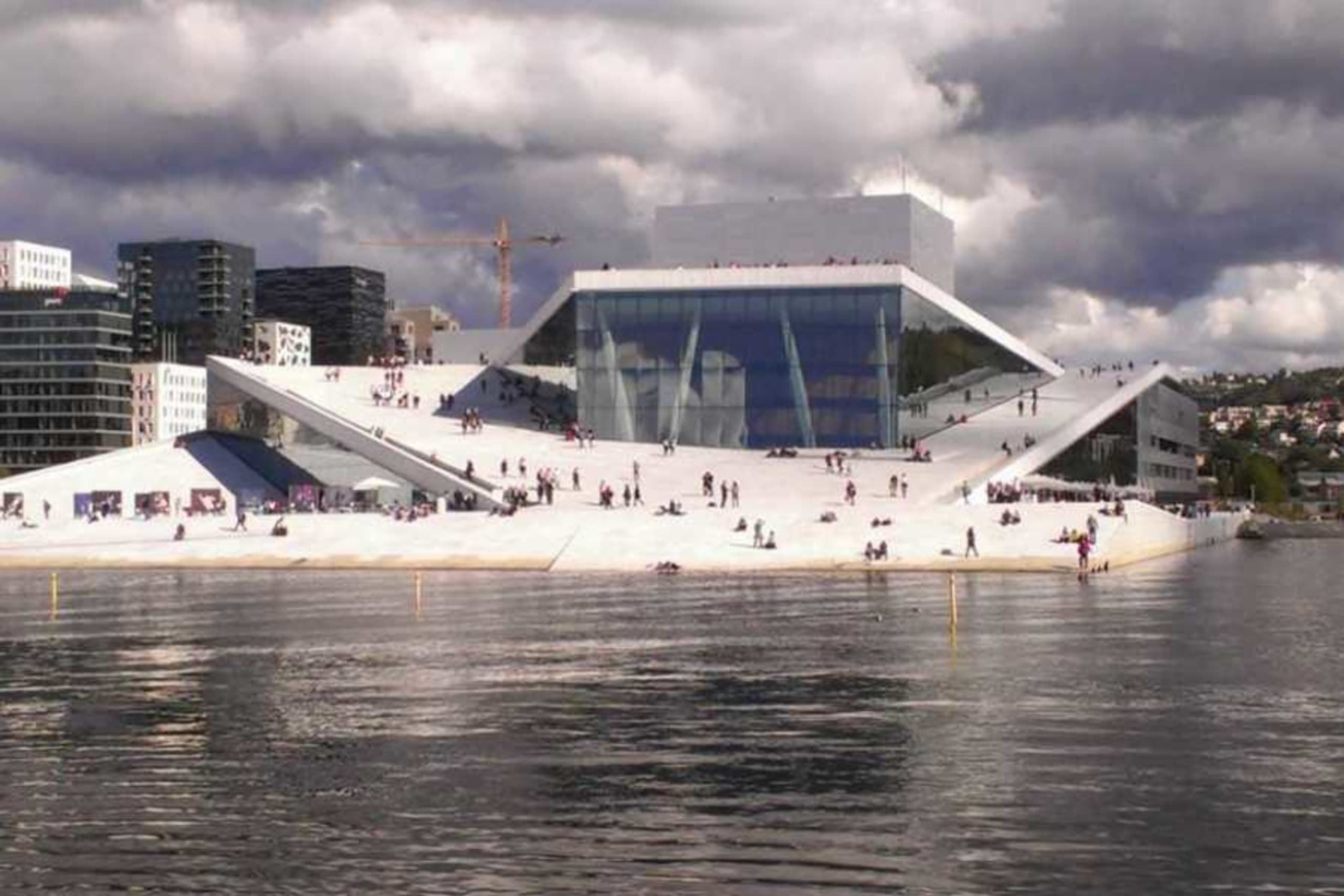 A view of the Oslo Opera House seen from the water.