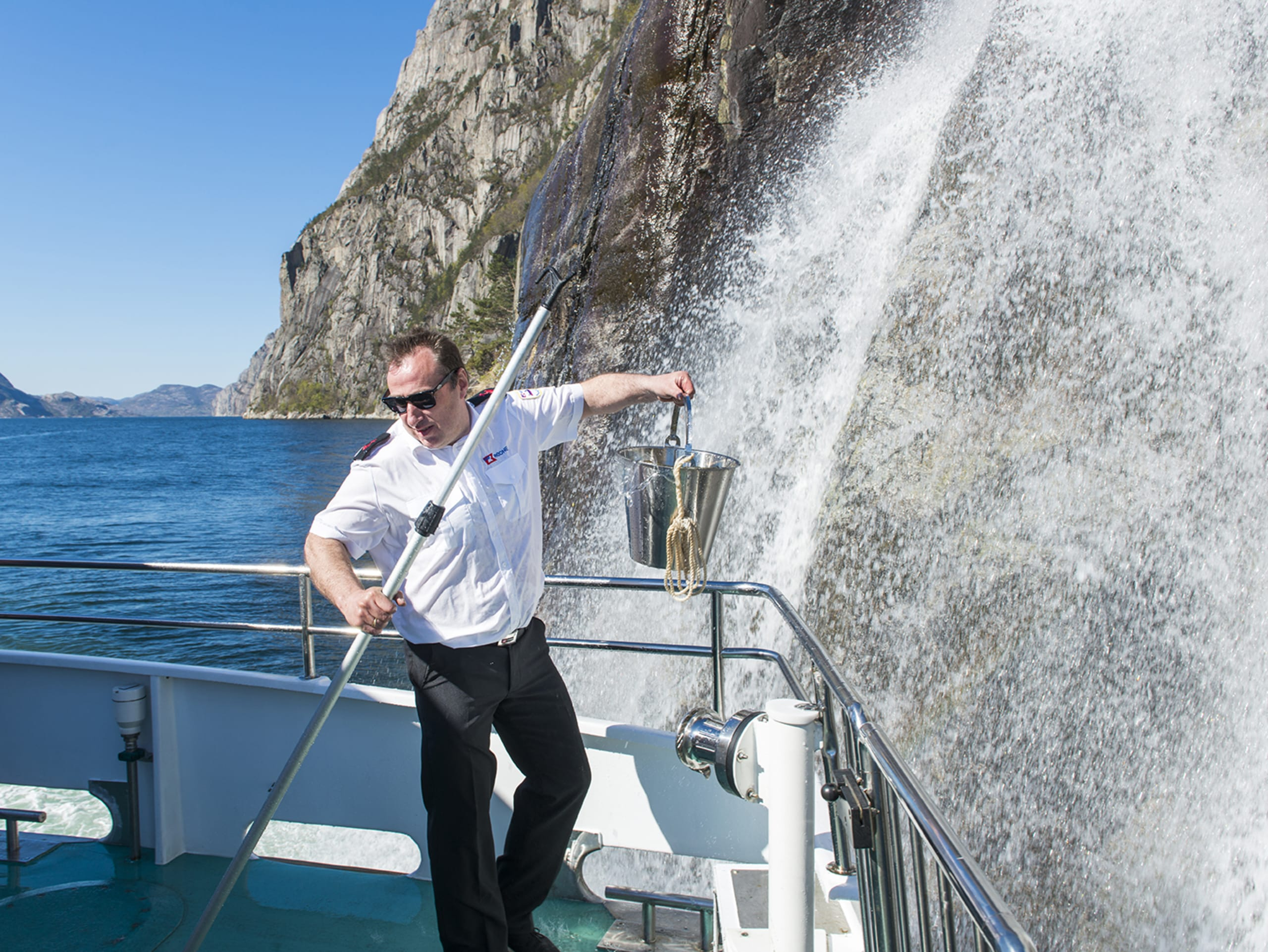 Captain getting water from Hengjanefossen waterfall