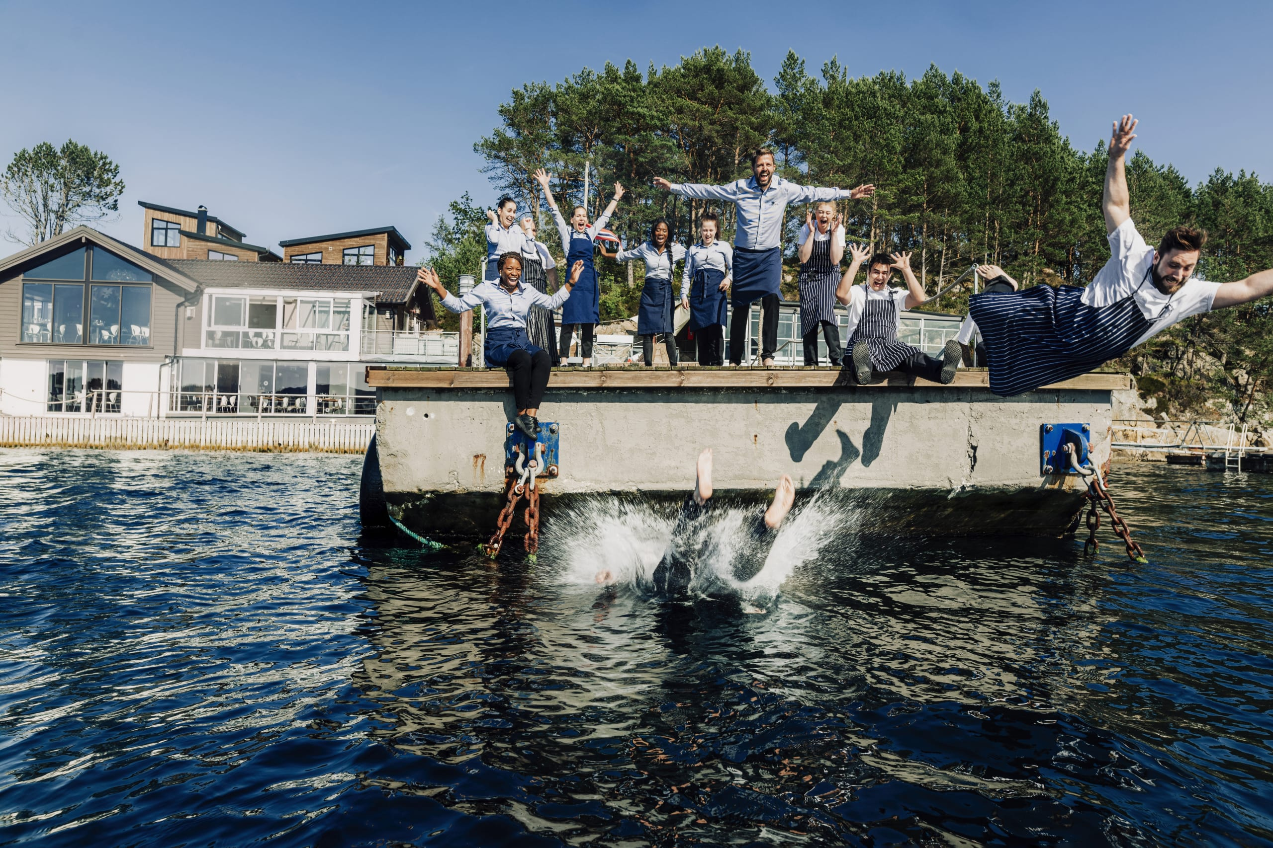 Chefs and crew jumping into the sea