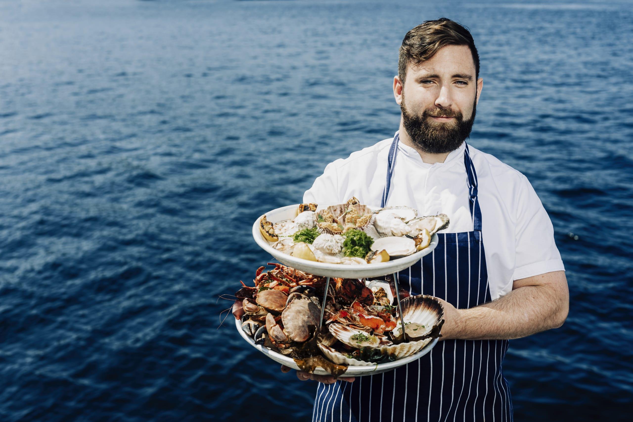Chef presenting shellfish tower