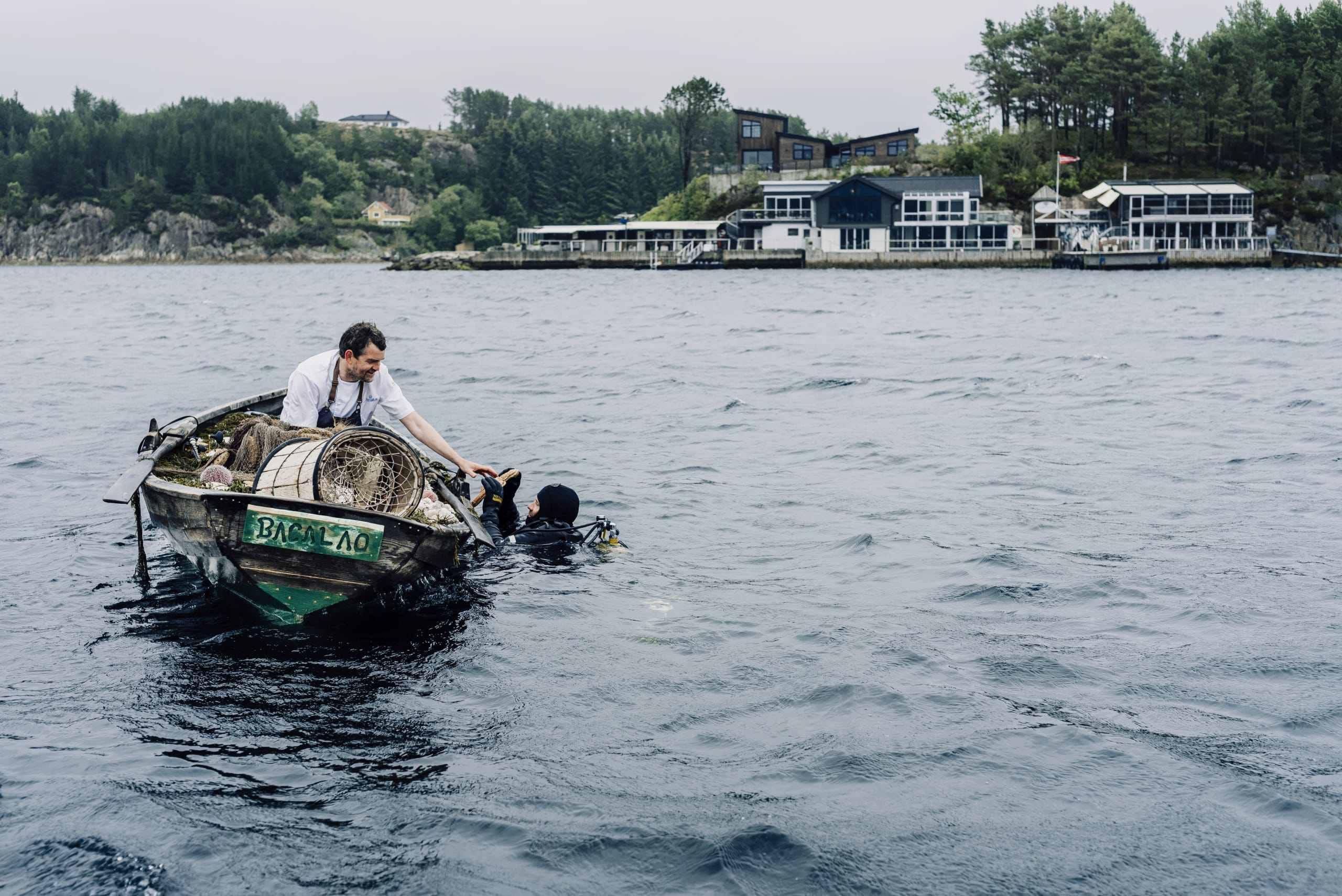 Diver harvesting shellfish outside Cornelius Seafood Restaurant