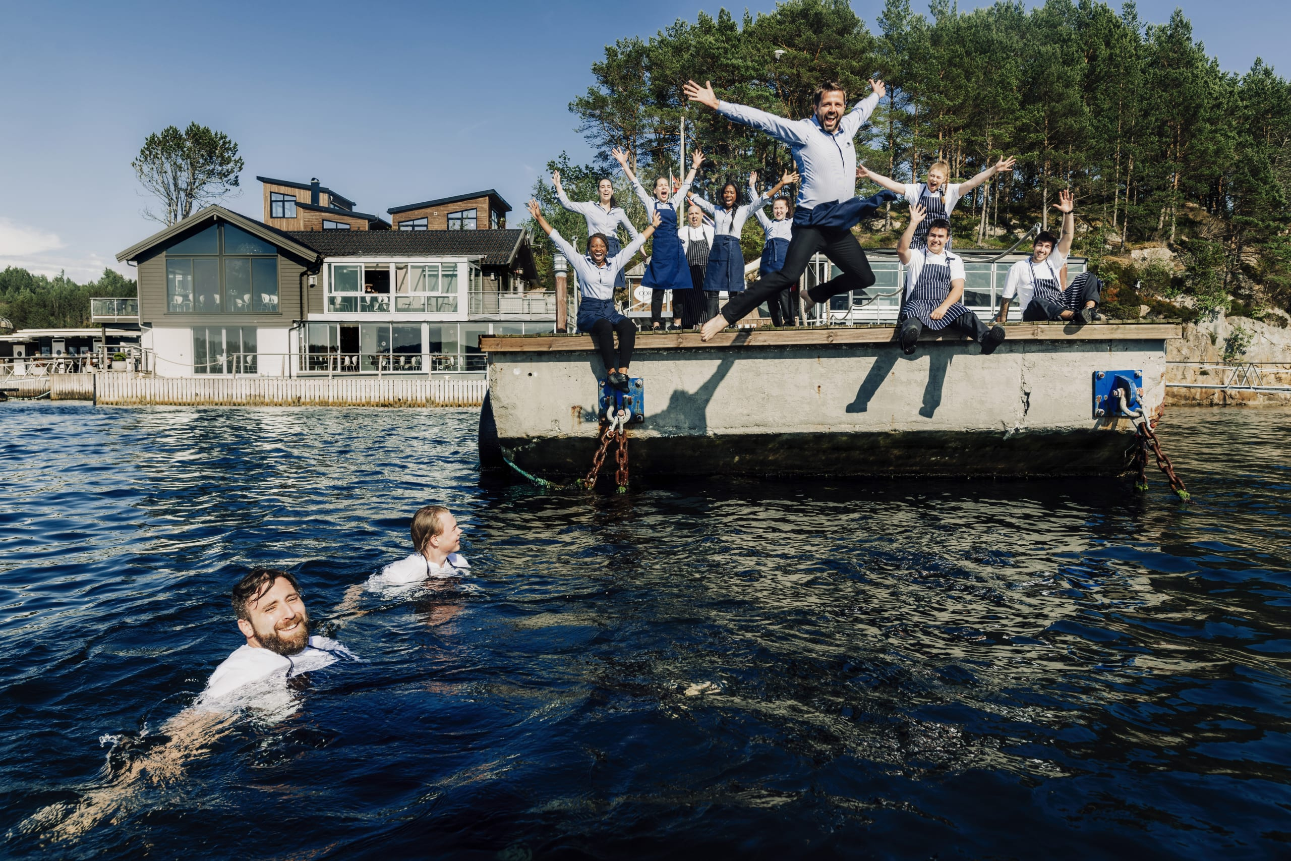 Chefs and crew jumping into the ocean
