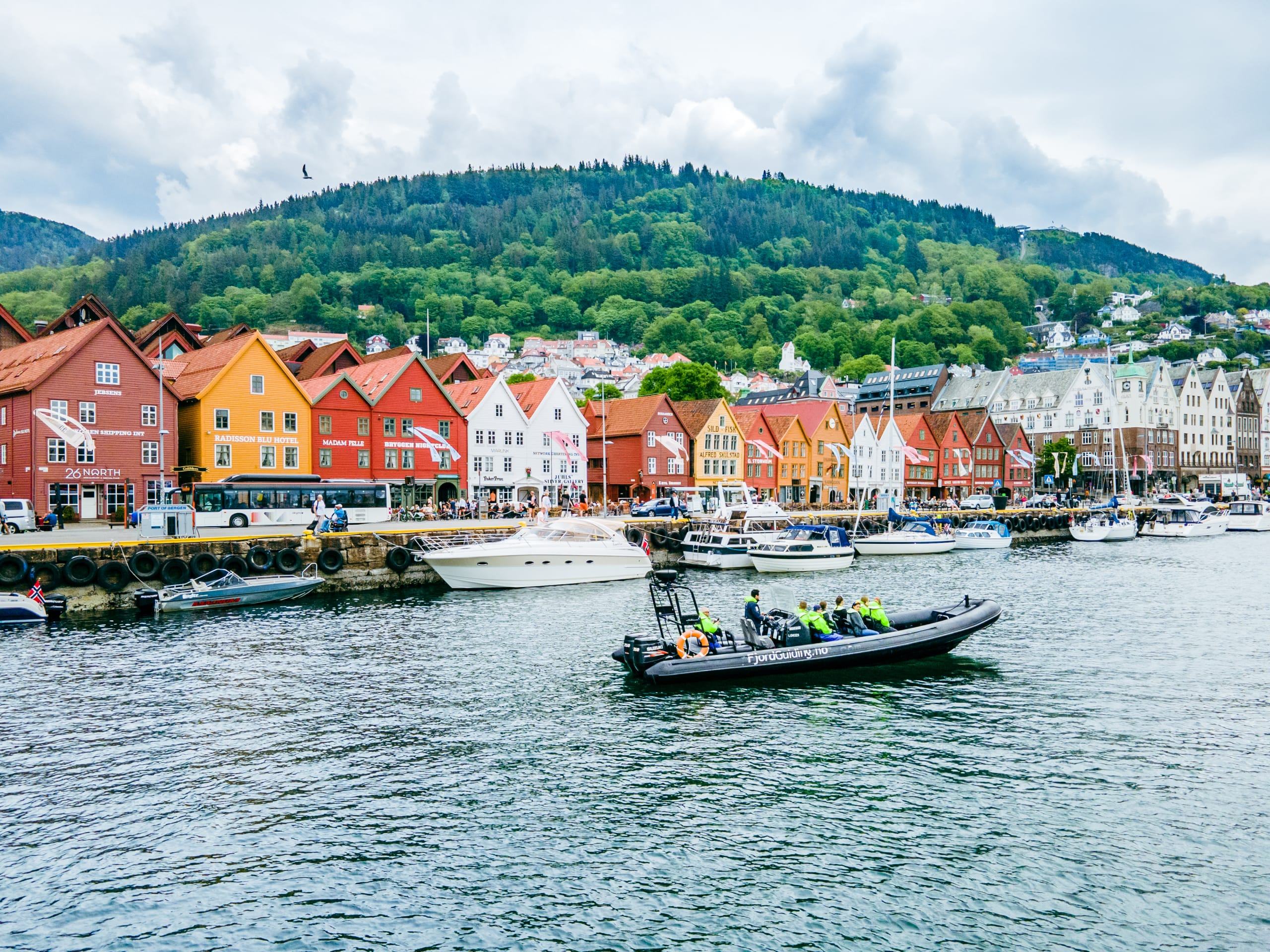 RIB boat cruising in Vågen in front of Bryggen Wharf