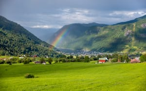 Rainbow over the fjord village of Vik in Sogn