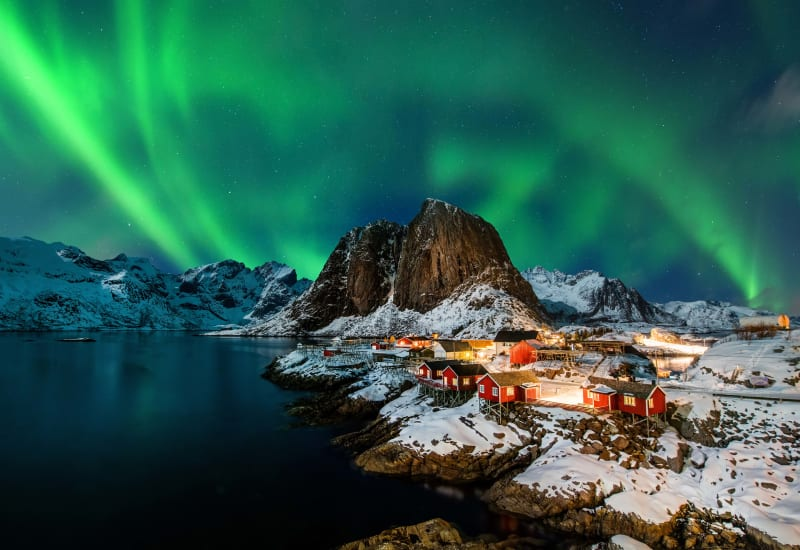Aurora Borealis dancing on the night sky above Hamnøy in Lofoten