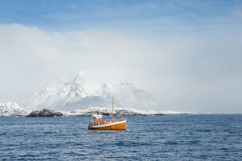 Authentic fishing boat on the fishing banks of the coast of Lofoten