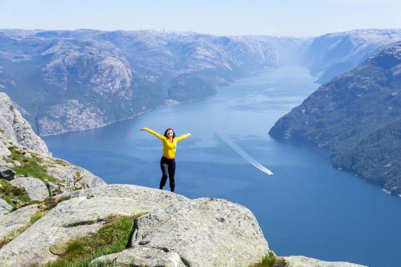 Happy woman on the top of Preikestolen