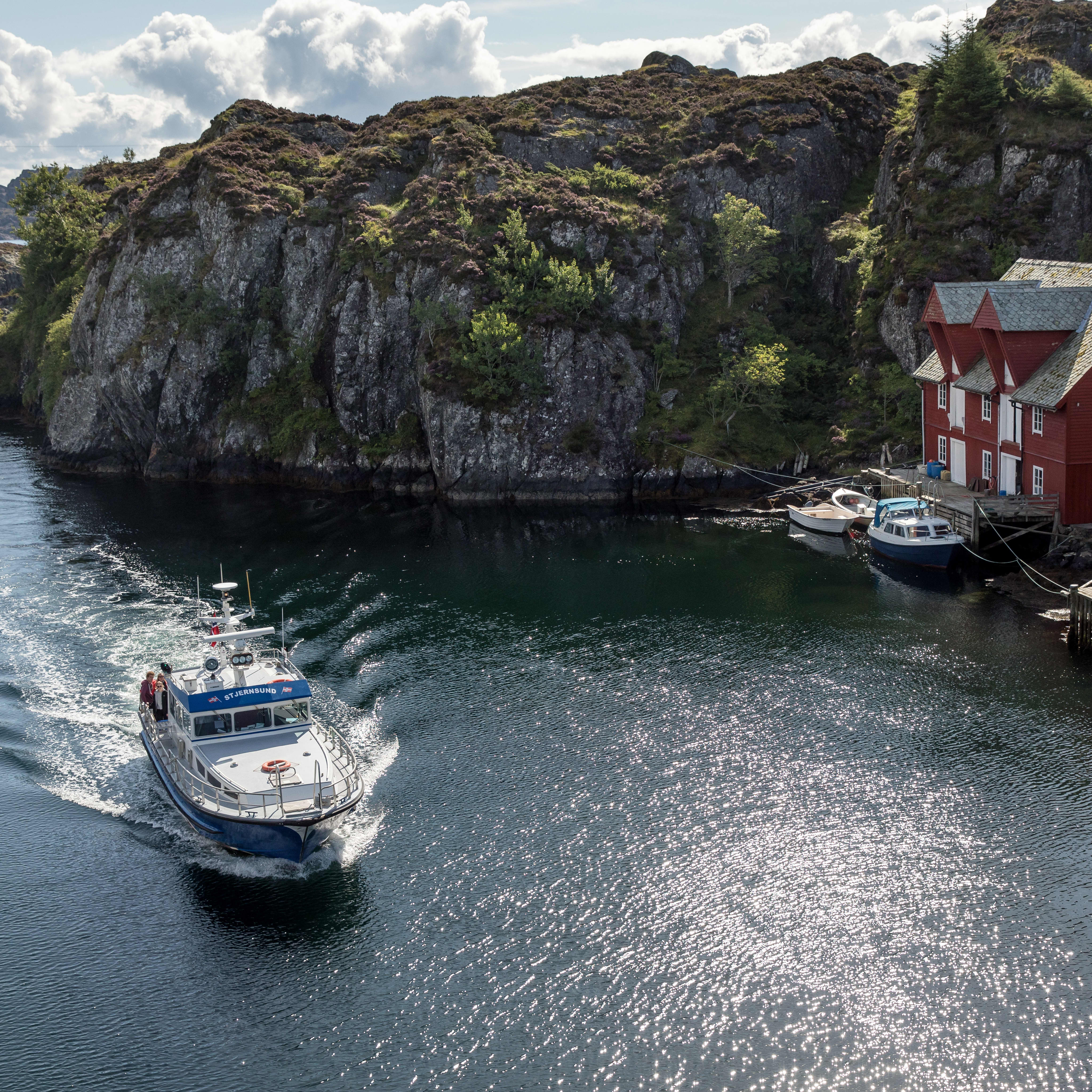 The local postal boat driving between small Western Norwegian communities dropping of mail and transporting tourists.