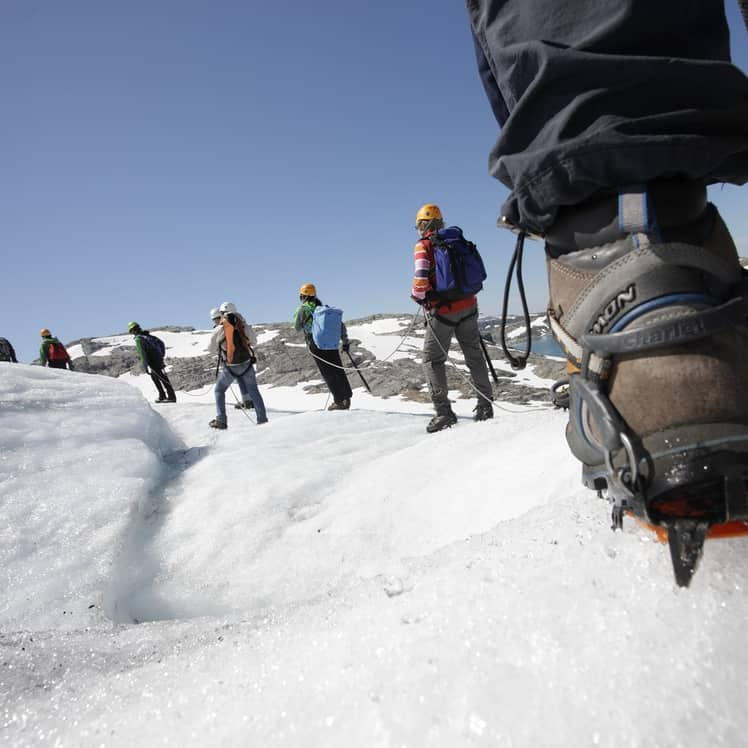 A group of people going for a glacier walk at Folgefonna glacier in Western Norway.